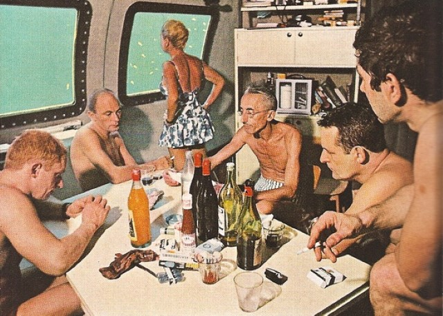 Jacques Cousteau with crew in galley