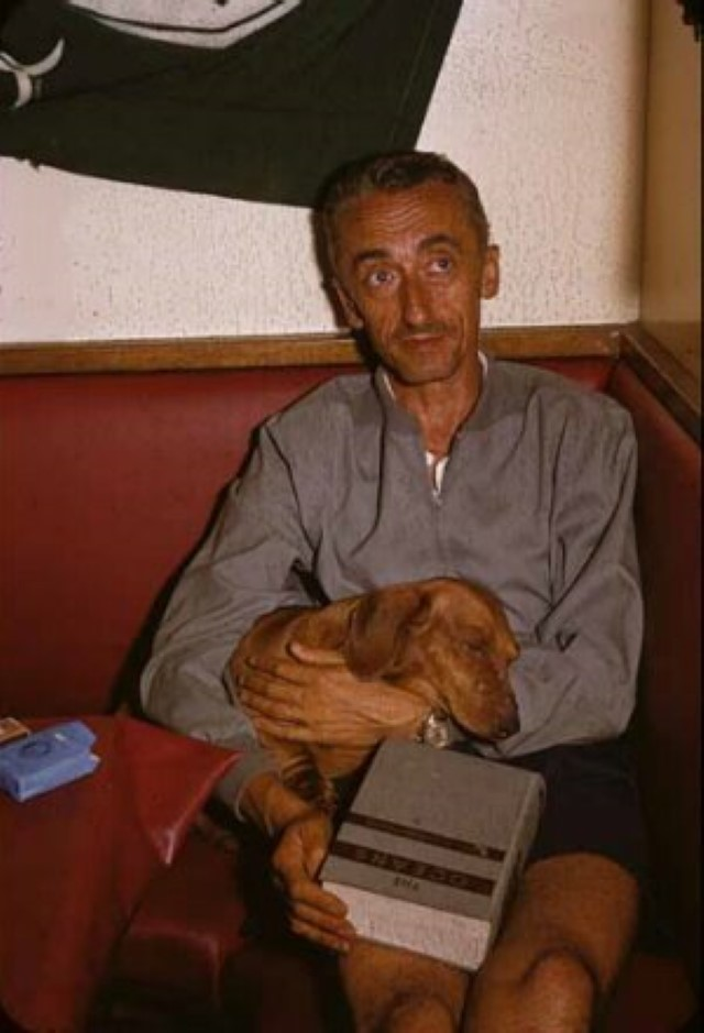 Jacques Cousteau with his sleeping dog