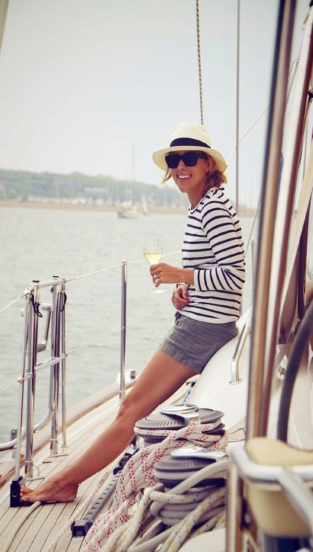 Girl drinking glass of wine on boat