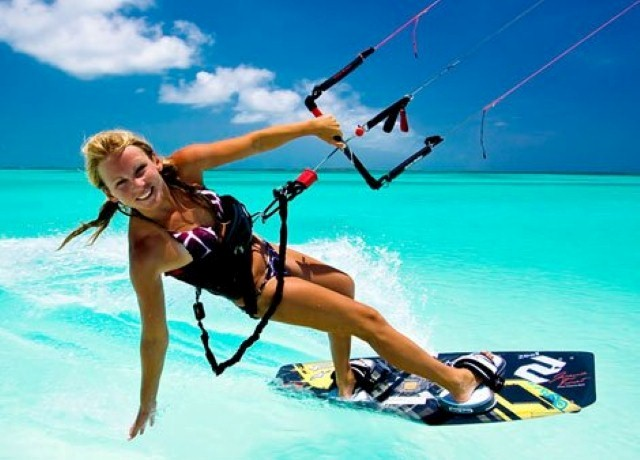 blonde kiteboarding in crystal water