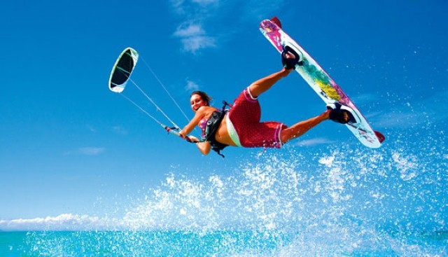 girl in pink shorts kiteboarding