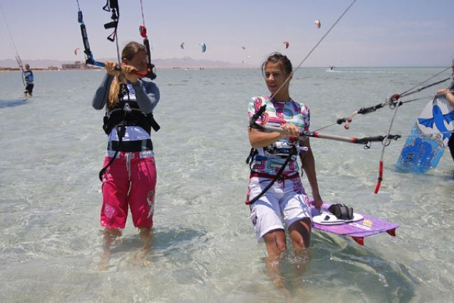 girls getting ready to ride kiteboards