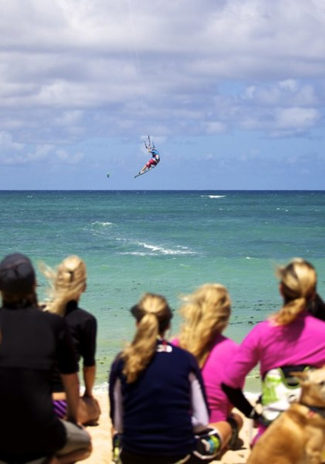 girls watching kiteboarder