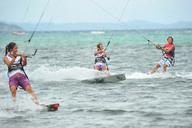 three girls kiteboarding