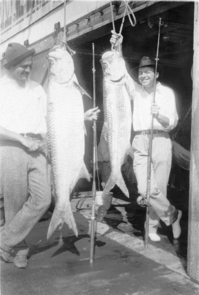 Ernest Hemingway and John Dos Passos pose with two tarpon fish, Key West, 1928..decryptedKLR