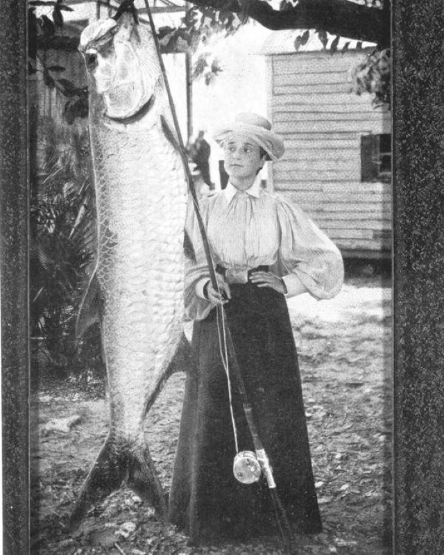 Love the fishing costume. Florida's Schultz Heitman with a 185-pound tarpon. Date 1921